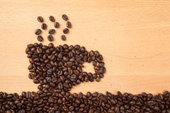 Roasted coffee beans in coffee cup shape Stock Photo