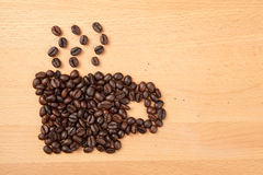 Roasted coffee beans in coffee cup shape Royalty Free Stock Photography