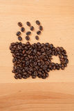 Roasted coffee beans in coffee cup shape Stock Photography