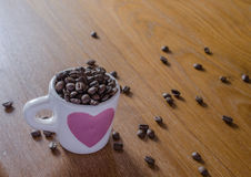 roasted coffee beans in coffee cup stock photo