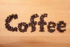 Roasted coffee beans in coffee word shape Royalty Free Stock Photos