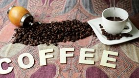 Roasted coffee beans on colorful cloth on the table. The word `coffee stock video footage