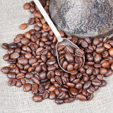 Roasted coffee beans and copper pot Royalty Free Stock Photos