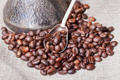 Roasted coffee beans and copper pot Stock Images