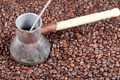 Roasted coffee beans and copper pot Stock Photography