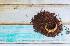Roasted coffee beans and a cup. Coffee beans for a coffee cup Royalty Free Stock Photography