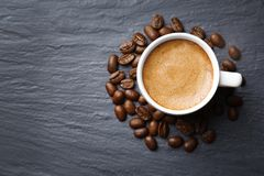 Roasted coffee beans with cup. On color background Royalty Free Stock Photos