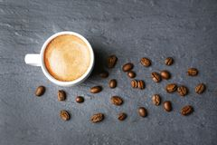 Roasted coffee beans with cup. On color background Royalty Free Stock Image