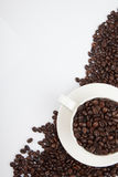 Roasted coffee beans with a cup Royalty Free Stock Photo