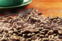 Roasted coffee beans and cups. Stock Image