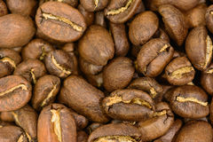 Roasted coffee beans in detail. Roasted coffee beans in macro detail Royalty Free Stock Photo