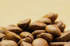 Roasted coffee beans in detail. Roasted coffee beans in macro detail on blured background Royalty Free Stock Photography