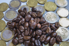 Roasted coffee beans with euro coins Royalty Free Stock Photo