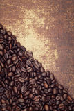 Roasted coffee beans on a faux leather material background Stock Photo