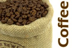 Roasted coffee beans in a flax bag Royalty Free Stock Image