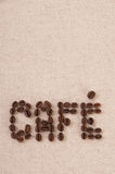 Roasted coffee beans forming the word cafe. On canvas Royalty Free Stock Image