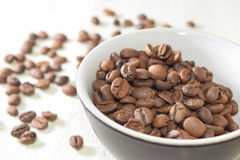 Roasted coffee beans. Fresh and roasted coffee beans Royalty Free Stock Photos