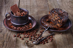 Roasted coffee beans and fruit cake over rustic wooden backgroun Stock Image