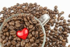 Roasted coffee beans in a glass cup. Love of coffee. We love coffee Stock Photos