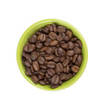 Roasted coffee beans in a green bowl Royalty Free Stock Image