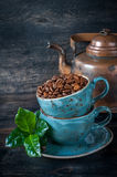 Roasted coffee beans with green leaves Stock Photography