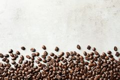 Roasted coffee beans on grey background with space. For text, top view royalty free stock photo