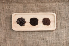Roasted coffee beans, ground coffee and coffee powder. Stock Photos