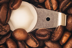 Roasted coffee beans are ground in a coffee grinder Royalty Free Stock Photography