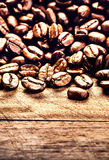 Roasted Coffee beans on grunge wooden background closeup. Fresh Royalty Free Stock Photo