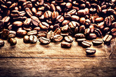 Roasted Coffee beans on grunge wooden background closeup. Fresh Royalty Free Stock Photography