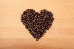 Roasted coffee beans in heart shape Royalty Free Stock Image