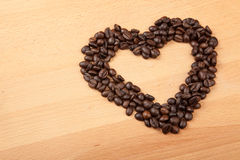Roasted coffee beans in heart shape Royalty Free Stock Images