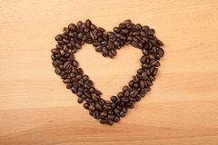 Roasted coffee beans in heart shape Stock Photography