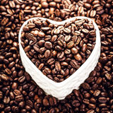 Roasted Coffee Beans in a Heart shaped  bowl at Valentine Day Ho Stock Photography