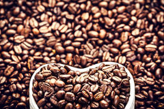 Roasted Coffee Beans in a Heart shaped  bowl at Valentine Day Ho Stock Photos