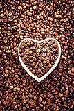Roasted Coffee Beans in a Heart shaped  bowl at Valentine Day Ho Royalty Free Stock Photos