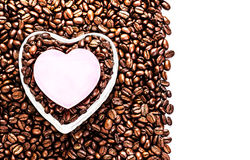 Roasted Coffee Beans with Heart Shaped Paper Sticker over coffee Stock Photo