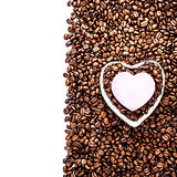 Roasted Coffee Beans with Heart Shaped Paper Sticker over coffee Royalty Free Stock Photos
