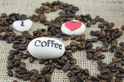 Roasted coffee beans with an Royalty Free Stock Image
