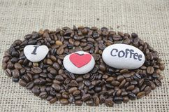 Roasted coffee beans with an Royalty Free Stock Photo