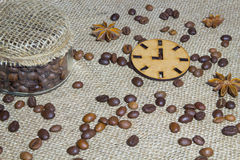 Roasted coffee beans, icon clock, star anise and jar of coffee Stock Images