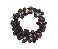 Roasted coffee beans isolated in white background. Circle roasted black coffee beans royalty free stock photography