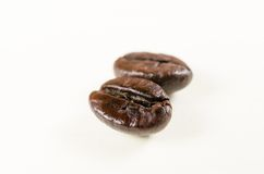 Roasted coffee beans isolated on white background Stock Photography
