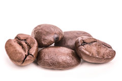 Roasted coffee beans isolated on white background. Close up Royalty Free Stock Image