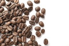Roasted coffee beans isolated on white background. Close-up stock images