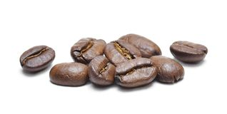 Roasted coffee beans, isolated on white background. Close-up shot of delicious arabica beans, pile or group of objects, cut out Royalty Free Stock Photography
