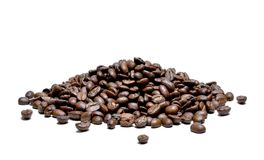 Roasted coffee beans, isolated on white background. Close-up shot of delicious arabica beans, pile or group of objects, cut out Stock Photos