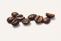 Roasted coffee beans isolated on white background. With copy space. Frame for creative concepts or advertising Royalty Free Stock Photography