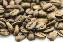 Roasted coffee beans isolated in white background Stock Photo