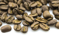 Roasted coffee beans isolated in white background Royalty Free Stock Photos